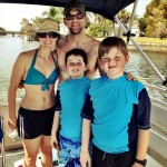 Family Swimming with Manatees