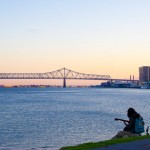 Man Playing Guitar on Mississippi River New Orleans