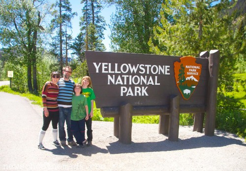 Family by Yelllowstone Sign